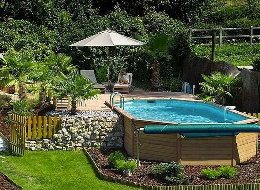 These 15 Above Ground Pool Ideas Win Over the In-Ground Ones ... on fiberglass pool ideas, inground pool ideas, christmas pool ideas, bedroom pool ideas, winter pool ideas, small pool ideas, painting pool ideas, courtyard pool ideas, barbecue ideas, florida pool ideas, city pool ideas, pool design ideas, garage pool ideas, backyard garden, backyard resort pools, outdoor pool ideas, cool pool ideas, side yard pool ideas, beach pool ideas,