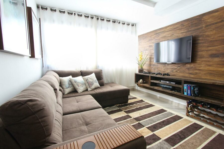 Modern room with a carpet that is adjusted to colors in the room and covers most of it