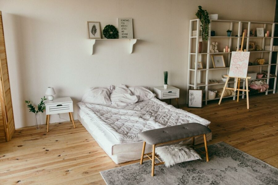 Simple bedroom with a small carpet